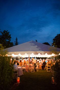 Get inspired: A cheery outdoors wedding reception at night. Simple tent, warm lighting, beautiful sky!
