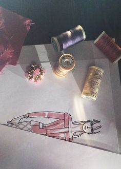 Sketches and spools of thread, a collection in the making - The Burberry Prorsum S/S14 collection shot with #iPhone5s #LFW