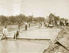 THE WORLD'S FIRST MILE OF CONCRETE ROAD - Paving Woodward Ave. in Detroit -   The Wayne County Rd Com. introduced the world to a new kind of road: Concrete. The only place it could be found that year was Woodward  between Six and Seven Mile Roads in Greenfield Twp., which is now northwest Detroit. Construction started April 20, 1909.