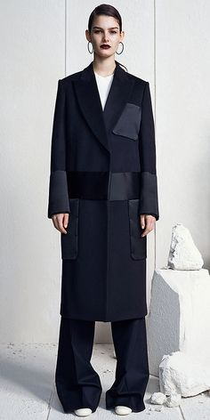 CÉLINE | Fall 2014 - MIDNIGHT DOUBLE FACE WOOL CASHMERE COAT 28L484318.07MI NAVY FLANNEL WOOL TROUSERS 21L654775.07MR OFF WHITE MERINO SILK LONG SLEEVES KNIT 23Z905635.01OW BLADE LARGE EARRINGS BLACK ENAMELLED BRASS 46E386BEN.38NO 95MM CREAM PATENT CALFSKIN & BLACK CALFSKIN ROUND TOE PUMP 315013MRT.38NO