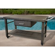 Open Air Lifestyles LLC Material Viro Wicker, Prussian Bronze Frame Construction: Powder Coated Aluminum          Warranty 3 Year Residential          Suitable For Commercial Use Yes          Console Table Material Wicker With Glass Top           Non-Marking Feet Yes           Assembly Required Yes
