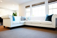 never would have thought of a white leather tufted sectional.  really pretty.  and kid friendly.