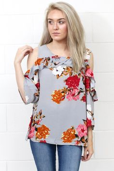 The perfect floral print blouse featuring open, cold shoulders with a ruffle detail that is a great fall transition piece! Sleeves hit about 3/4 length. Lightweight material. Non-sheer. Cool grey mix.