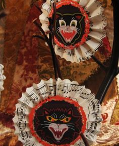 Vintage halloween paper rosettes. Could be easily adapted to Christmas ornaments.