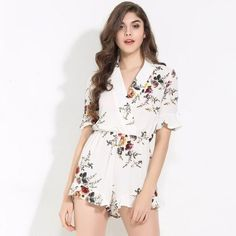 9f88cddfdcd Keep your floral wardrobe on point this season with this gorgeous white  floral playsuit! This. Fashion Genie Boutique USA