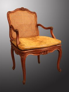 A Louis XV  beechwood desk armchair caned . Loose brown leather seat cushion. Period 18th century . >> For sale on Proantic by galerie Pellat de Villedon