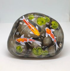 Koi pond painted rocks, beautiful garden decor and unique gifts for nature lovers Pond Painting, Lily Painting, Pebble Painting, Painted Rock Animals, Painted Rocks, Hand Painted, Fish Rocks, Pet Rocks, Drawing Rocks
