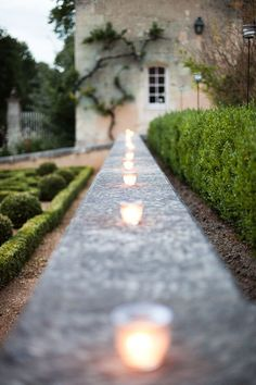 Candles on a garden wall