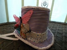 Whimsical Butterflies and Ladybug Mad Hatter Handmade One of a Kind Burlesque Circus  Mini Top Hat  Fascinator. $95.00, via Etsy.
