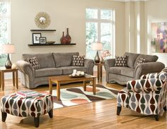 Our Cobblestone living room group by Woodhaven includes sofa, loveseat, coffee table, two end tables and lamps and rug.