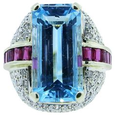 Large Aquamarine Ruby Diamond Ring   From a unique collection of vintage cluster rings at http://www.1stdibs.com/jewelry/rings/cluster-rings/
