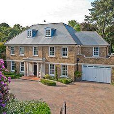 Eamonn Holmes and Ruth Langsford could move to London after slashing the price of their Surrey mansion by 7%. The £3.5 million Weybridge mansion in Surrey has six bedrooms