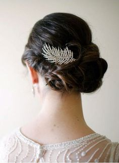 A chic Art Deco hair comb compliments a low twisted bun perfectly for your #wedding hair.