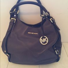 Michael Kors handbag A Michael Kors brown purse in good condition. It's a soft brown leather purse with three compartments great storage. Michael Kors Bags Hobos