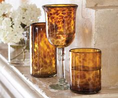 "Tramonti Tortoise Collection; Hand-selected amber, deep bronze, and clear recycled glass, artisans achieve a rich ""tortoise shell"" effect in these elegant goblets, tumblers, hurricanes, platter and serving bowl.  Mouth-blown glasses are formed in hand-built brick kilns and will show variations in dappled color.  From napastyle.com"