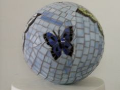 Mosaic Bowling Ball..great for in the garden as a gazing ball.  Breaking dishes is a great stress relief.