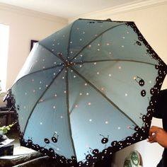 One of a kind Soot Sprite umbrella, designed after Hayao Miyazaki's Spirited away soot sprites. Made from 100% polyester pongee waterproof fabric. Measures 41 inches in diameter and 33 inches long Note: This will be shipped directly from Hong Kong.