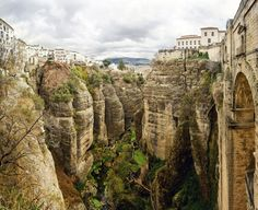 Picture of Amazing view of the Ronda canyon and the famous white village in Province of Malaga, Andalusia, Spain stock photo, images and stock photography. Oh The Places You'll Go, Places To Travel, Beautiful Places In Spain, Ronda Spain, Spain Holidays, Destinations, Spain Travel, Photos, Pictures