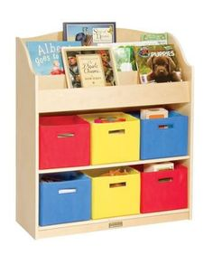Six fabric storage bins and three rows of book storage make the Book and Bin Storage a must for the classroom or home. Easy-clean laminate construction ensures years of use. Storage bins are perfect for holding books, toys or media, and help create a clean, uncluttered environment. Assembly required. Ages 3+.