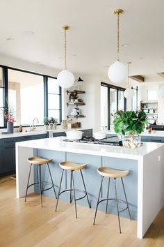 Waterfall countertops are here to stay, and they look stunning. Take a look at a collection of some of the most jaw-dropping kitchens with this trend.