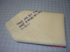 A handkerchief for the groom embroidered with a personal message and the wedding date