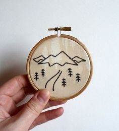 Hand Embroidery For Beginners Mini mountain landscape sketch embroidery hoop. The design is embroidered using back stitch with black DMC thread, on Art gallery fabrics Wooden Embroidery Hoops, Embroidery Hoop Art, Hand Embroidery Patterns, Ribbon Embroidery, Cross Stitch Embroidery, Machine Embroidery, Embroidery Digitizing, Embroidery Tattoo, Embroidery Tools