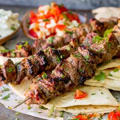 Marinated succulent lamb, juicy and beautifully charred. These Greek Lamb Souvlaki Kebabs are so tasty. Cook them on the BBQ for added flavor! Lamb Kabobs Recipe, Lamb Kebabs, Shish Kabobs, Kabob Recipes, Grilling Recipes, Cooking Recipes, Healthy Cooking, Healthy Food, Marinated Lamb