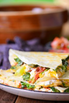 This Chicken Club Quesadilla recipe is a fast, easy meal idea that is full of flavor. These quesadillas are stuffed with chicken, bacon, cheese and salsa!