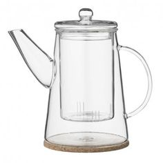 An elegant clear glass teapot and cork coaster from Bloomingville. The minimal design and use of glass makes this a stylish tea pot to adorn your dinner table with.