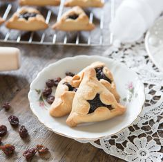 Hamantaschen -- rolled cookies with a prune/raisin filling, made Paleo! This dough could be used for many different varieties of cookies.