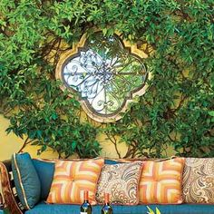 accessorize outdoor space with mirrors (this one is beautiful!) Hung on a garden wall, a mirror acts like a window to another space.  And 25 more Thrifty Ways to Create Outdoor Dining - Photo: Mark Lohman | thisoldhouse.com |