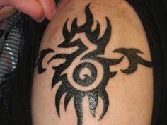 Tribal Capricorn symbol tatt