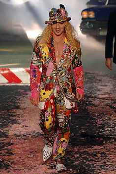 John Galliano poses at the end of the Spring/Summer 2006 Men Ready-to-Wear collection show in Paris.