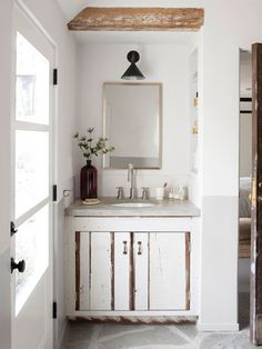 A metal funnel makes a cool industrial lampshade in this bathroom. #decorating