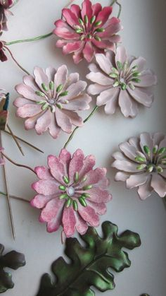 Metal Flowers -- Wonder if I could do something like this with aluminum cans...?