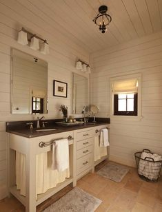 I am not so sure about the styel of the vanity, but I do like the towel bars. The bars may work if they were slightly smaller and mounted to the front of a cabinet door, so that the vanity would make more sense and allow for additional storage.