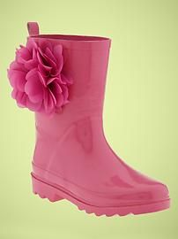 These girl's rain boots are too cute, and easy to replicate with a less expensive pair of boots, and a hand-made, or craft store set of flowers-just scotch guard them (the flowers).  Blooming Rain Boots  www.gap.com