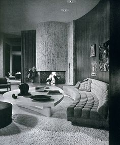 The living room of Mr. and Mrs. Eugene V. Klein's Trousdale Estates, Beverly Hills, residence. Interior design by Arthur Elrod. (Spring 1963) George R. Szanik, Leeland Lee, Fritz Taggari
