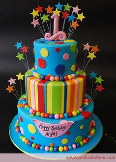 This colorful 3 tier polka dot and striped cake was created for a 1st birthday party.