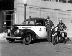 Chief V. B. Brown gives a demonstration of the first two-way radio telephone in the Glendale Police Department's patrol cars, 1938. The motorcycle officer is Wes Owen. The call letters KQCI became the identifier of the Glendale Police Department radio telephone. Glendale Central Public Library. San Fernando Valley History Digital Library.
