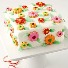 Ice store-bought flower cookies to decorate this quick-and-easy cake from Parents.com
