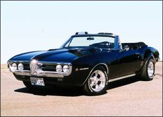 1967 Pontiac Firebird convertible with polished American Racing Torq Thrust II wheels