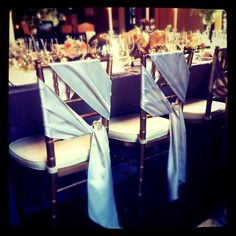 I snagged this photo from Starla Steward Holl several months ago. This is a great alternative to chair covers and can be done pretty inexpensively with the right fabric.