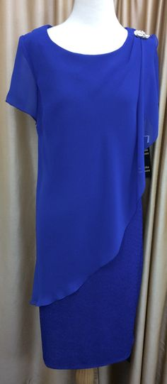 Electric blue lurex with overlay chiffon front and back. Finished with diamond brooch on one shoulder. Eve Hunter .