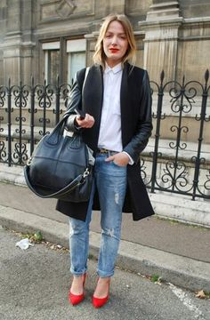 Simple but so cool: Ripped jeans, a white button-down (buttoned to the top), a leather-sleeved overcoat, and a pop of color on her feet.   Read more: http://stylecaster.com/winter-chic-40-stellar-street-style-outfits-copy/#ixzz3BZmx8g4C