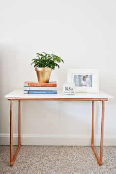 "Marble and copper sure make a pretty duo, don't you think? I have been having such a fun time coming up with new ways to incorporate the two into my home and my latest little nightstand has proven very useful. Especially when I have fresh flowers to place on top - because what is more refreshing than waking up to flowers?   Materials 1/2 inch Copper pipe (cut into 4 15"" pieces, 2 20"" pieces, and 2 10' pieces) // Pipe cutter // Marble tile in 12x24"" (I found this at Home Depot) // Gorilla…"