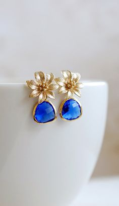 Gold Flower Blue Sapphire Glass Post Earrings. Blue by LeChaim, $26.00