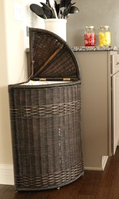 Hide your garbage with our corner lidded wicker waste basket! Shop by size, style, and function at www.basketlady.com
