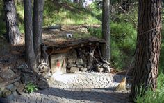 This cute little hobbit home cost just $100 to build