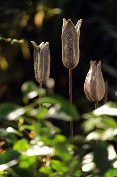 Trio of seed pods, stoneware with oxides, £ 180. sucloudceramics.com